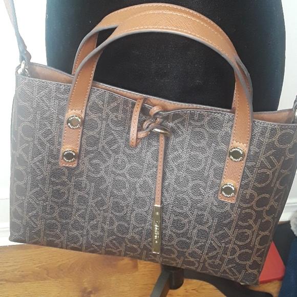 641f8f250 Calvin Klein Handbags - Calvin Klein Branded Purse and inside Purse